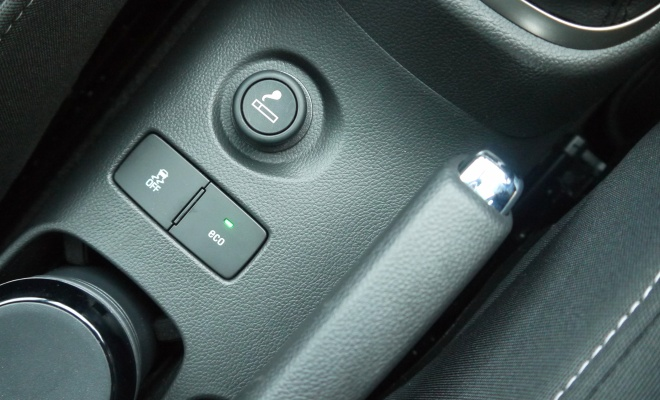 Eco button near handbrake