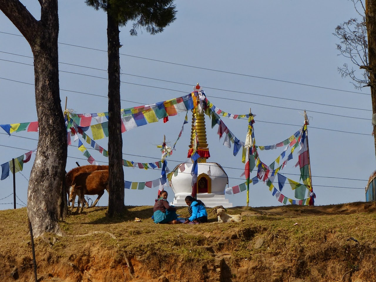 Kids sitting near a Buddhist stupa, Nepal