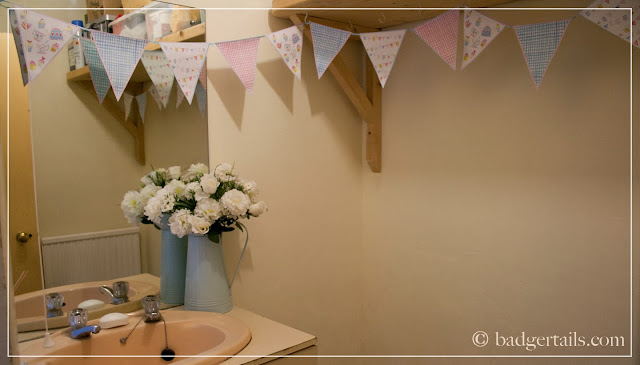 cloakroom makeover cream walls bunting decorating DIY