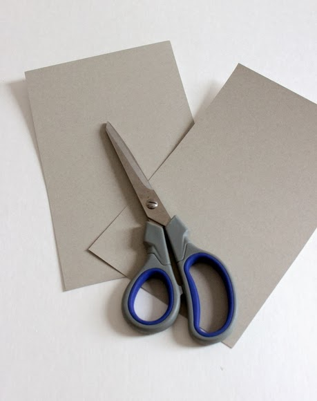 Use lightweight cardboard and a scissors to create a cover for the Christmas Card Book.