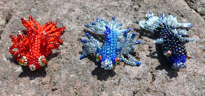 Three Fancy Fish by Alison Oman with peyote stitch bodies