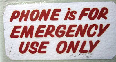 Red-lettered sign reading Phone for emergency use only with graffiti saying The invisible phone