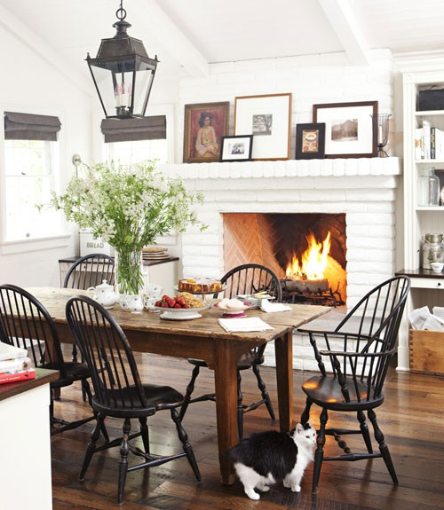 really love this casual dining room with the raised hearth fireplace
