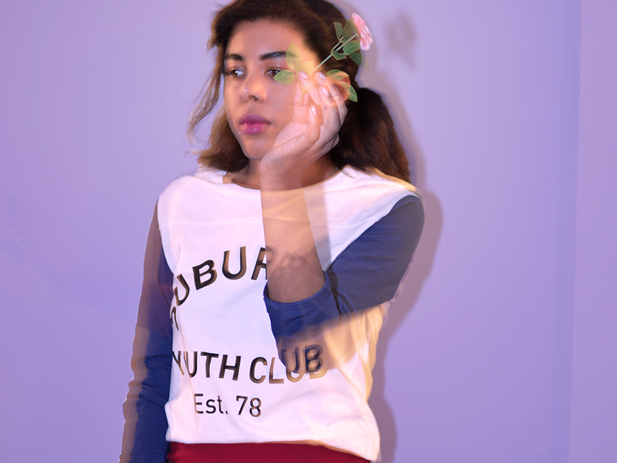 Indie Fashion Blogger Anais Alexandre of Down to Stars in top shop baseball tee and red skirt looking psychedelic