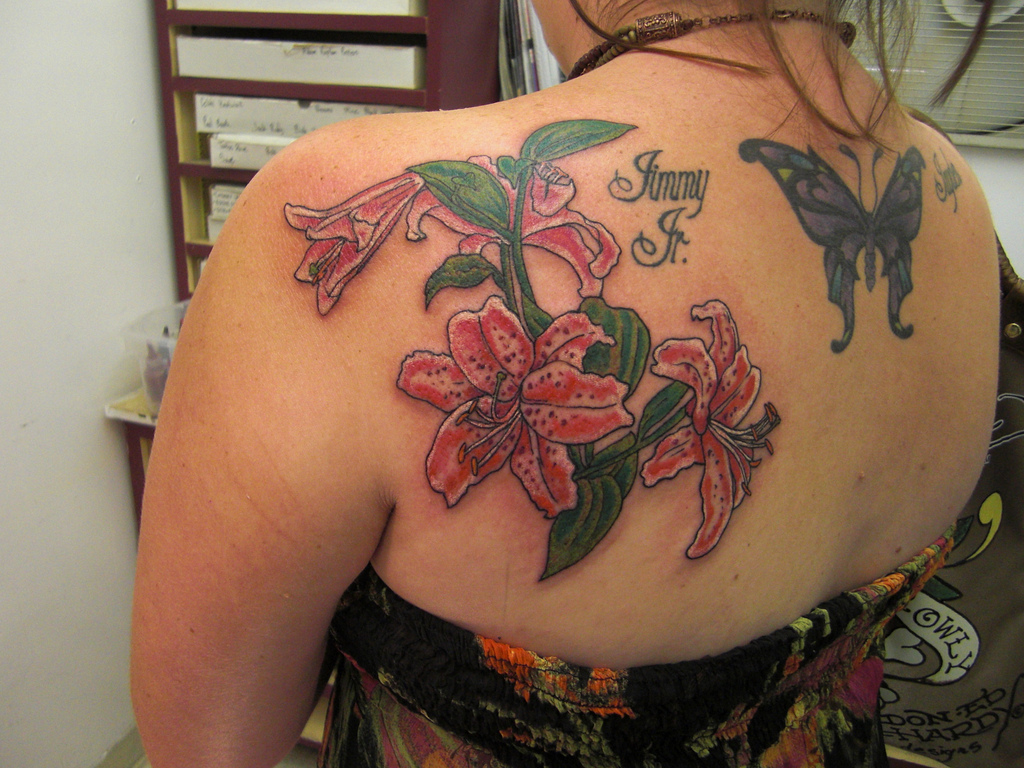 Lilies tattoo designs info liturgical the lily is a symbol of easter and of christ himself of resurrection and immortality it is evocative smell the smell of chastity izmirmasajfo
