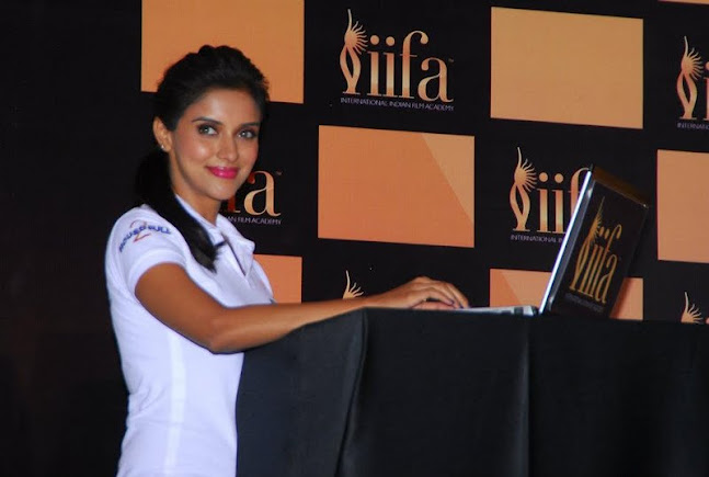 Asin wearing a white shirt working on laptop @ IIFA 2012 - Asin in Iifa awards 2012 white shirt pics
