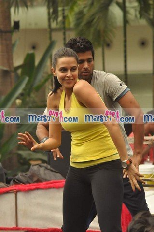 Neha Dhupia in Black tights and yellow top1 - Neha Dhupia Practice for Sahara Star Seduction