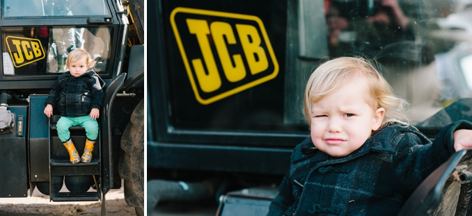 adorable little boy at the farm on a JCB tractor photo by STUDIO 1208