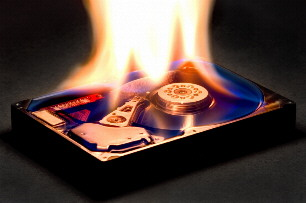 Picture of a computer's hard disk in flames of fire.