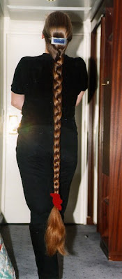 Rapunzel very long braid beautiful woman with floor length hair