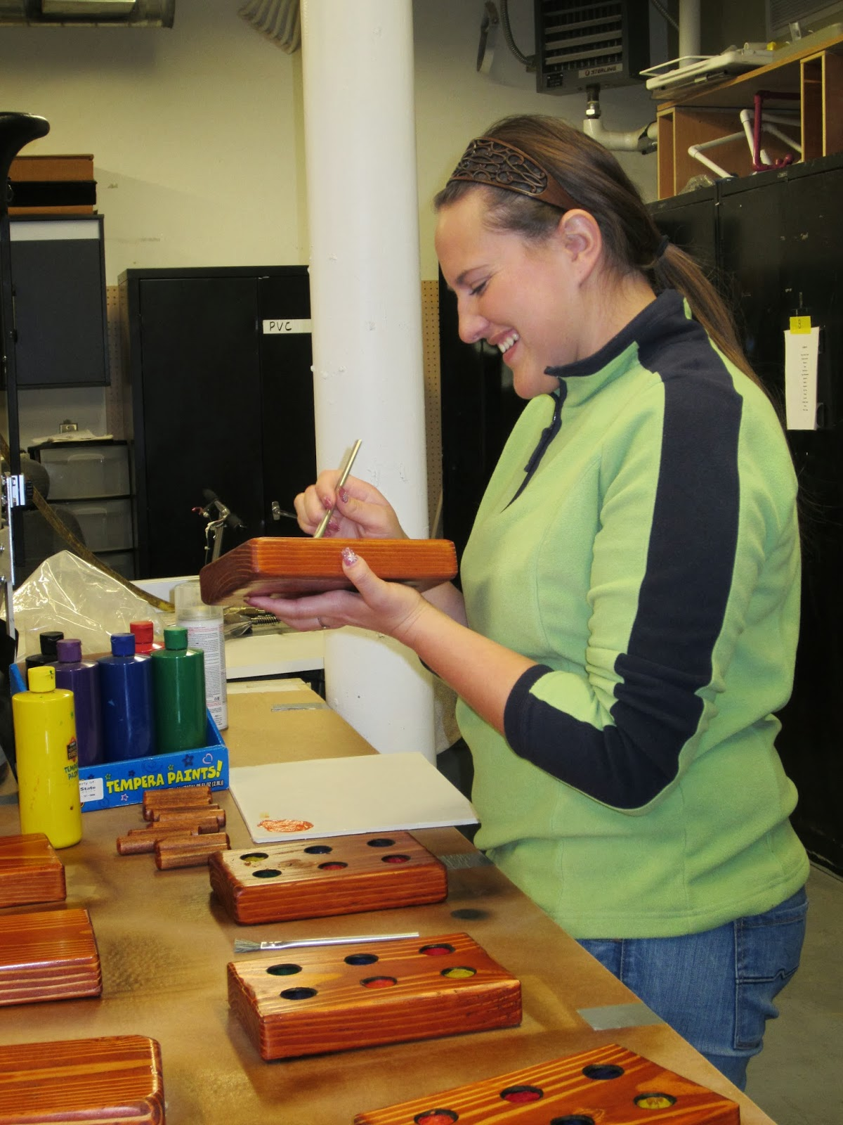 Carlotta Foitzick paints puzzles for  the Up to 3 program at the AT lab.