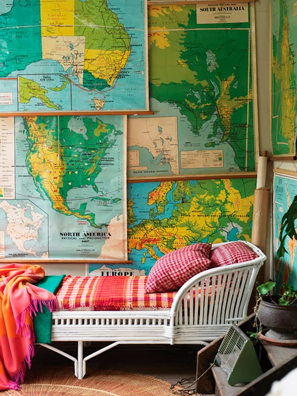 Layer vintage maps for a wall treatment.