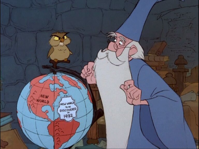 Merlin studies the globe Sword in the Stone animatedfilmreviews.blogspot.com