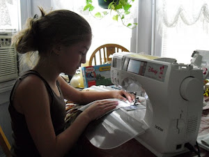 Me sewing First Quilt