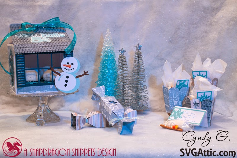 Winter scene in blue with cupcake holder, popcorn cups and cracker boxes