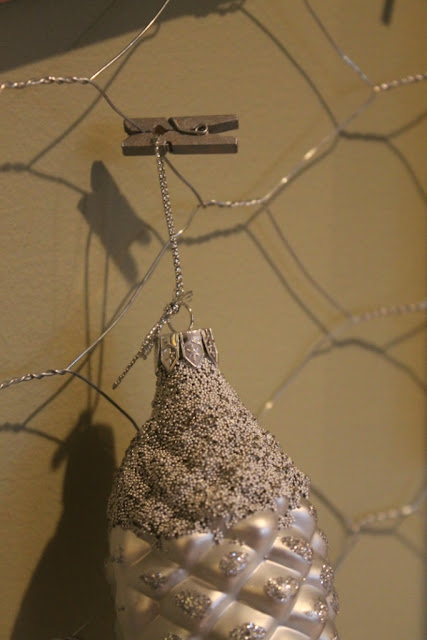 attach ornaments to chicken wire
