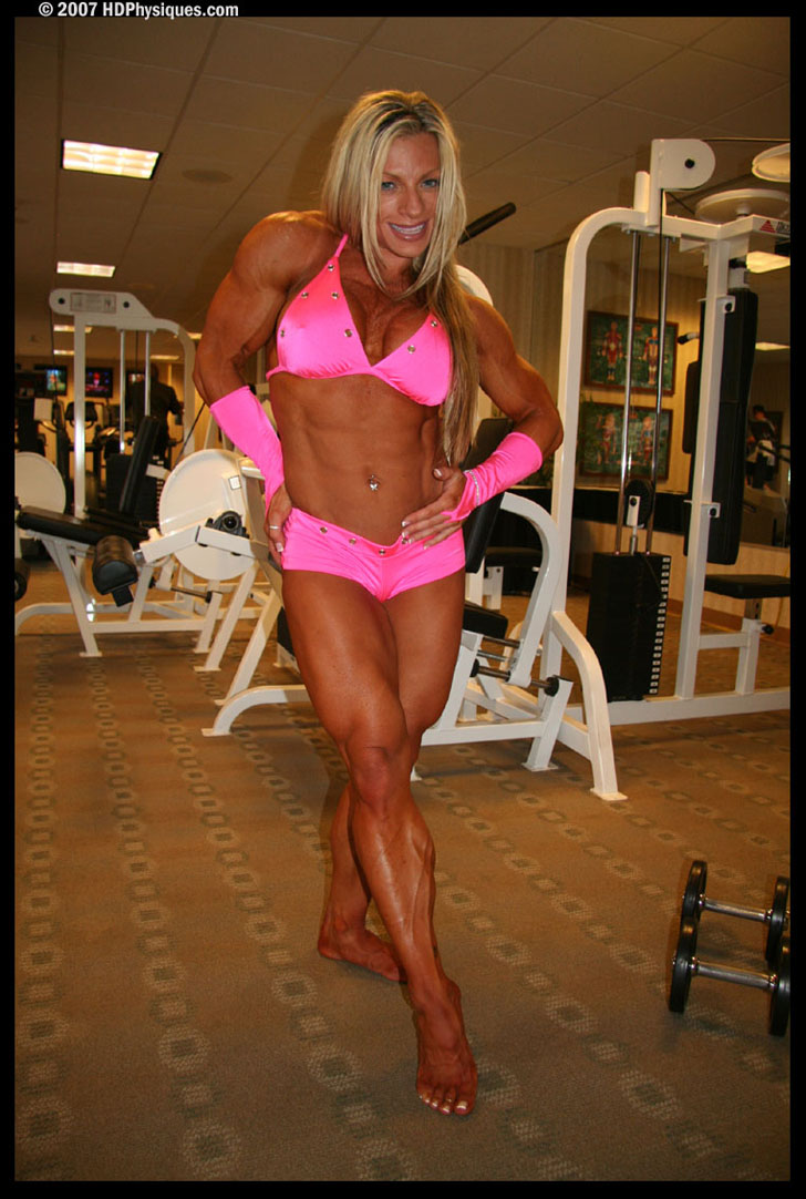 Debi Laszewski Models Her Shredded Muscles In A Pink Bikini