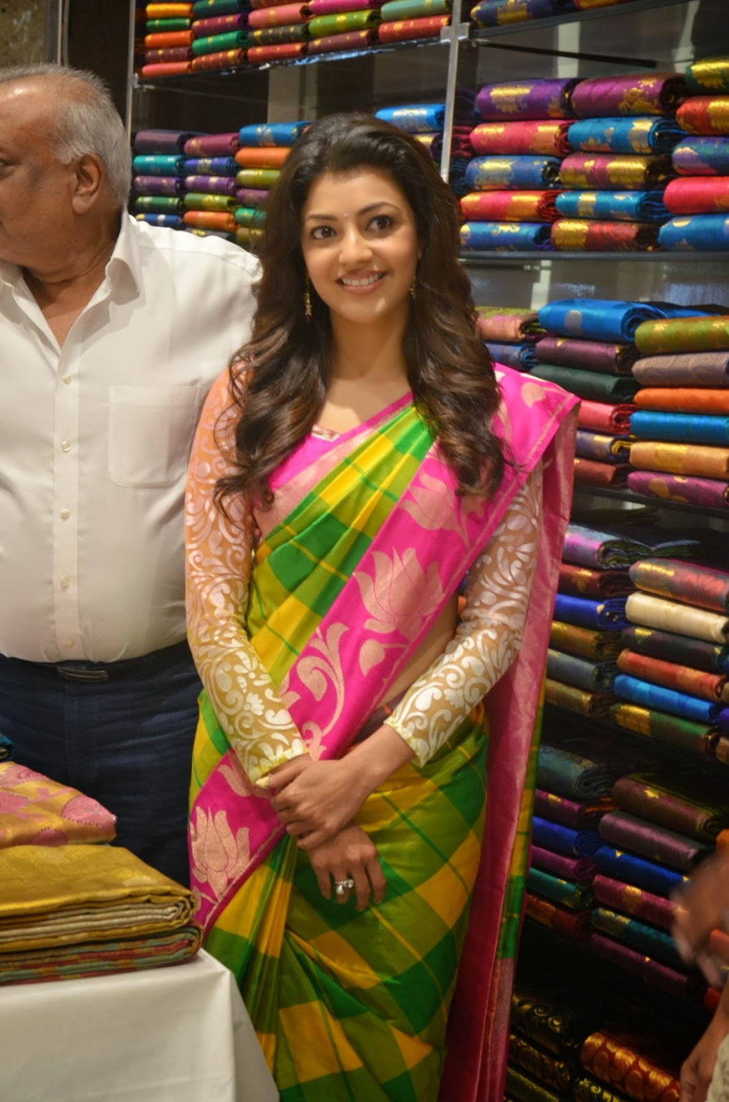 Cute Kajal agarwal photos in ethnic saree at shopping mall launch