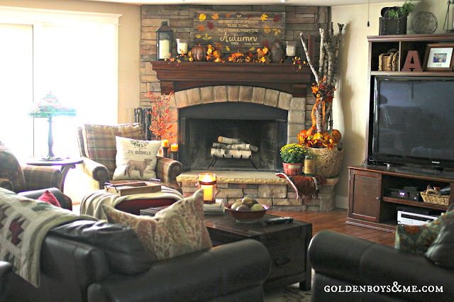 fall family room with corner stone fireplace and pallet sign with birch logs, part of Fall Mantel via www.goldenboysandme.com