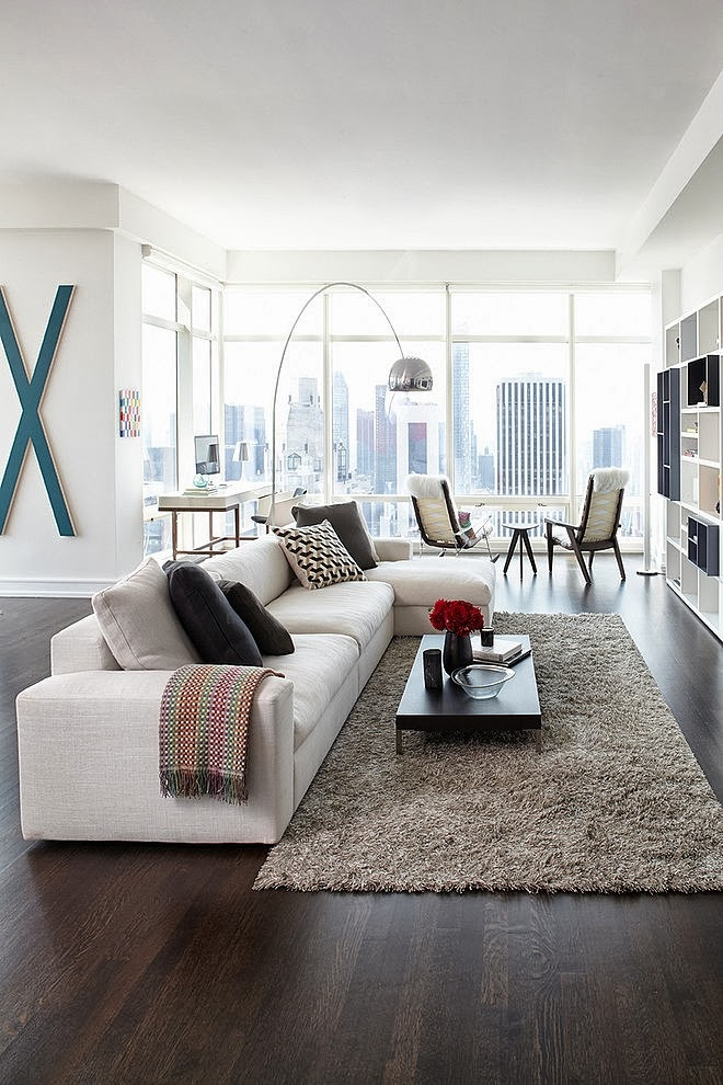 Living room furniture in Modern apartment by Tara Benet in New York