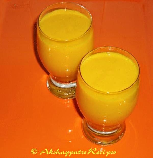 banana mango milkshake in serving glasses
