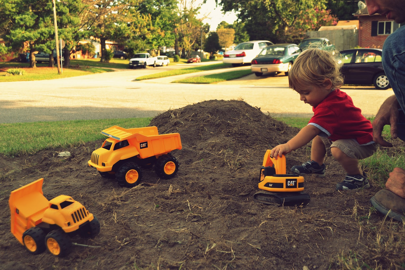 Boys are encouraged to play with cars, fostering an earlier development of driving skills.