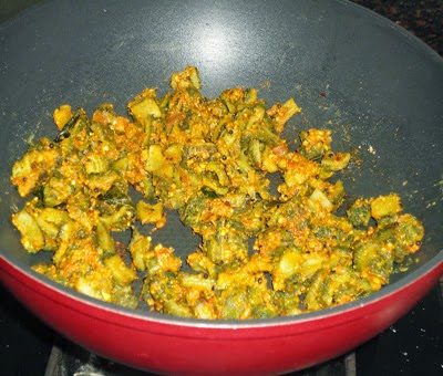 sprinkle besan and saute - preparing  karlaychi peeth perun bhaji recipe
