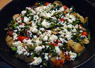 Veggies in Saute Pan Sprinkled with Basil and Feta