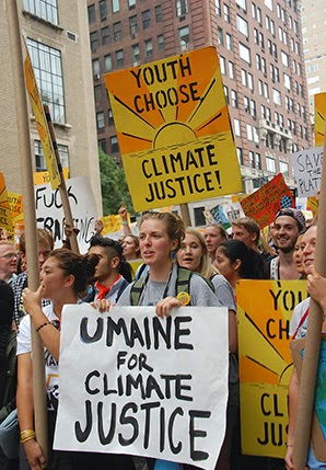 "Millennials led a protest in New York's Central Park last September demanding ""system change, not climate change,"" but a new poll suggests they're not likely to change much. (Photo Credit: Thomas Altfather Good / Flickr) Click to Enlarge."