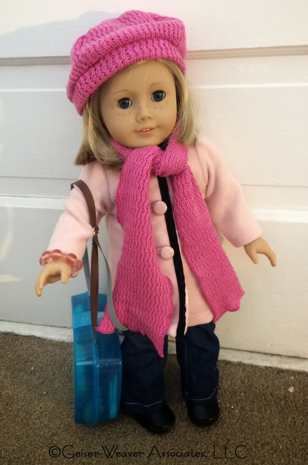 Kit is going on a traveling adventure- outfit by Geiser-Weaver Associates, LLC