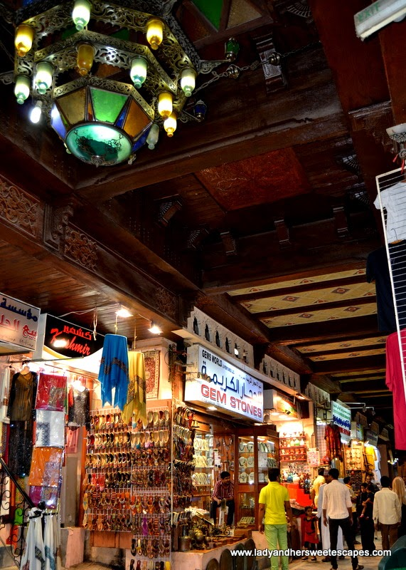 chandeliers and carved wood ceiling in Mutrah Souq Oman