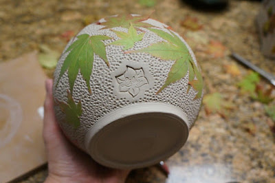 Beautiful leaf imprint and textured ceramic pottery hand thrown vessel - in progress.