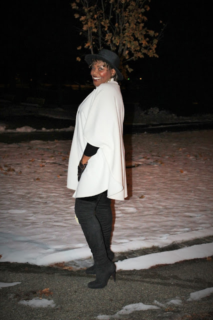 snow-in-view-while-wearing-winter-white-cape-over-black-velvet-leggings