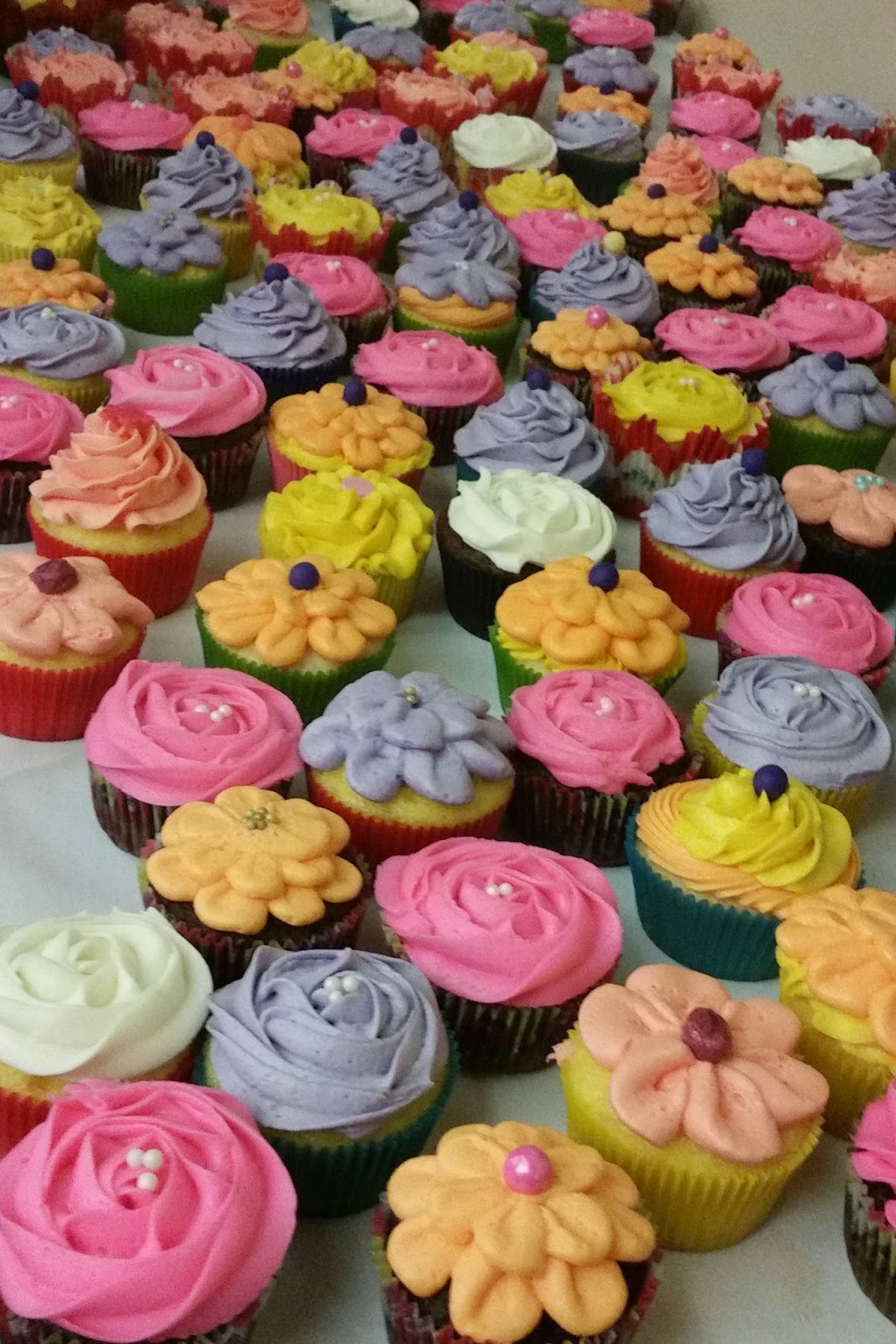 Cupcakes and treats by terrilu spring flower cupcakes 200 spring flower cupcakes i made for a dear friends celebration of life all frosting no fondant used on these beautiful spread of flower cupcakes izmirmasajfo