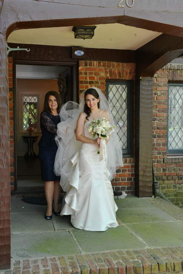Bride and her Mom leaving house for wedding