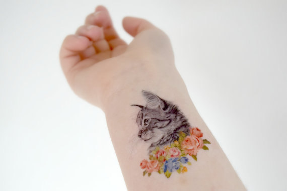 https://www.etsy.com/uk/listing/197058838/cat-in-flowers-temporary-tattoo-ink?ga_order=most_relevant&ga_search_type=all&ga_view_type=gallery&ga_search_query=cat%20temporary%20tattoos&ref=sc_gallery_2&plkey=1bb8758de8011f2b2a3cc407d4215ed412957c0a:197058838&zanpid=2116442780556727296&utm_medium=affiliate&utm_source=zanox&utm_campaign=row_buyer&utm_content=977275