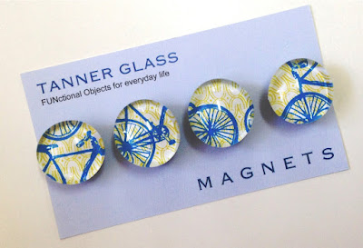 4 magnets, in blue and yellow, with bicycle designs
