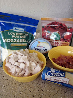 Ingredients for this recipe: mozzarella cheese, cream cheese, cooked chicken, bacon bits, sun dried tomatoes, and crescent rolls