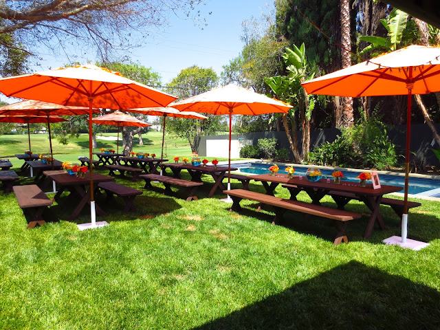Outdoor backyard baby shower orange umbrellas pool creative centerpieces