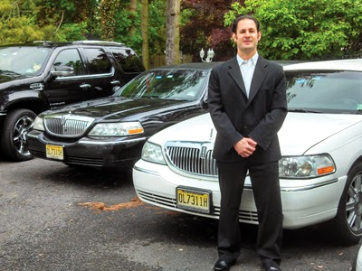 Ross Martin stands in front of Ross Limousine's diverse fleet