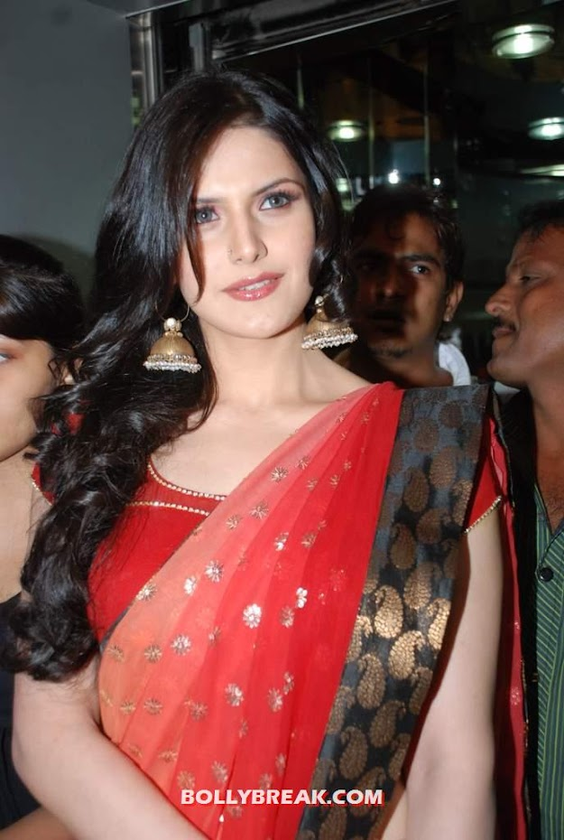 Zarine khan looks super gorgeous in a red Saree with black border -  Zarine Khan In Red Saree Hot Photos