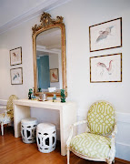 . are covered in a Barclay Butera print and the club chair is in a .