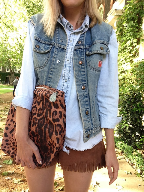 leopard print clutch, fringe leather shorts, chambray shirt