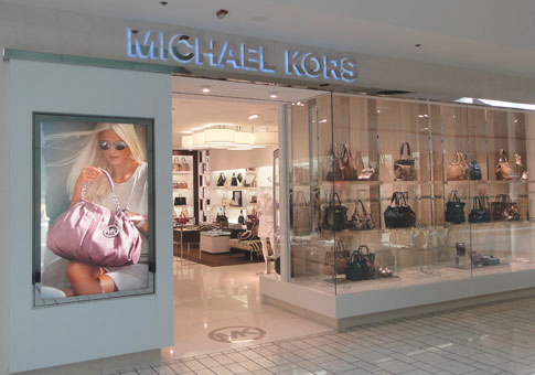 michael kors positioning of the website and retail stores. Black Bedroom Furniture Sets. Home Design Ideas