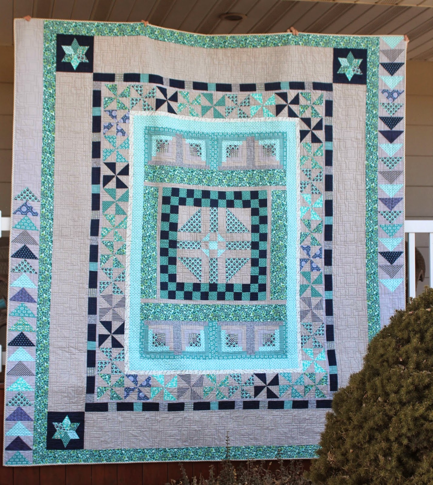 Navy, gray and aqua round robin quilt