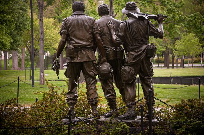 Dedicated in 1984, the Three Soldiers Memorial depicts the three soldiers looking onto the Vietnam Veterans Memorial Wall.