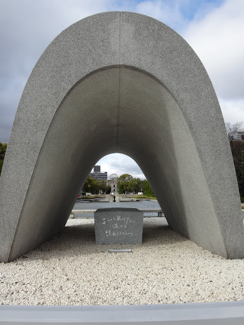 Hiroshima Memorial Monument contains the Register of Deceased of A-bomb victims with the inscription offers a prayer  to the victims in Japan
