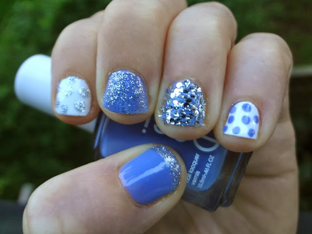 Blue polish with silver glitter, white polish with polka dots