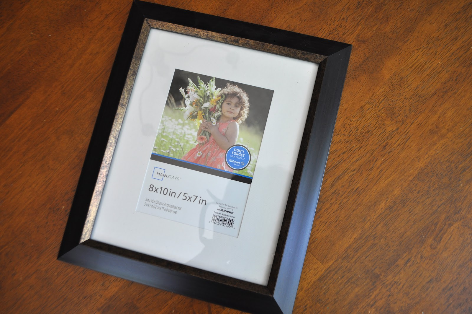 i printed up the photos at costco 150 for 8x10s i used fabric scraps for some of the frames as well