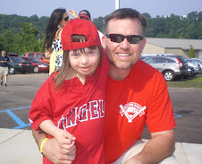 Chloe with Major League Baseball Star Sean Casey at the opening of the New Miracle League Field